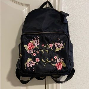 black backpack with floral details
